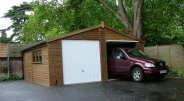 Timber Garage with car in