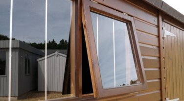 Integral security bars on a garden shed