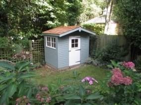 Pretty shed with roof overhang