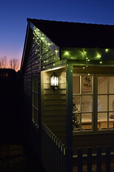 Icicle lights on the front of our Pavilion Garden Room