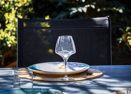 A Place Setting At An Al Fresco Dining Area