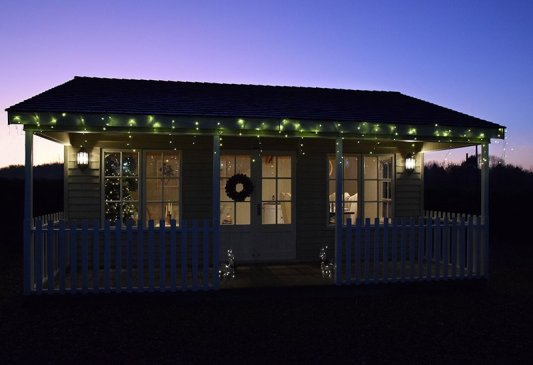 A Pavilion Garden Room adorned with Christmas Lights