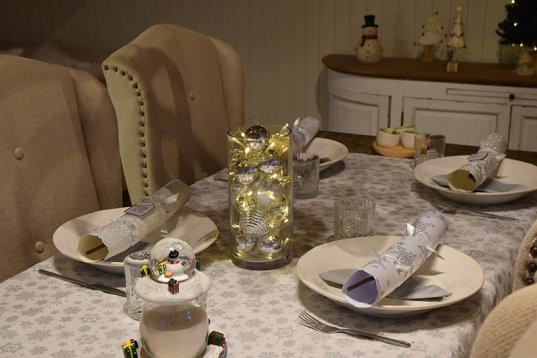 Decorate a table with a festive table runner, crackers, and lights and host your Christmas Dinner inside your Garden Buildings