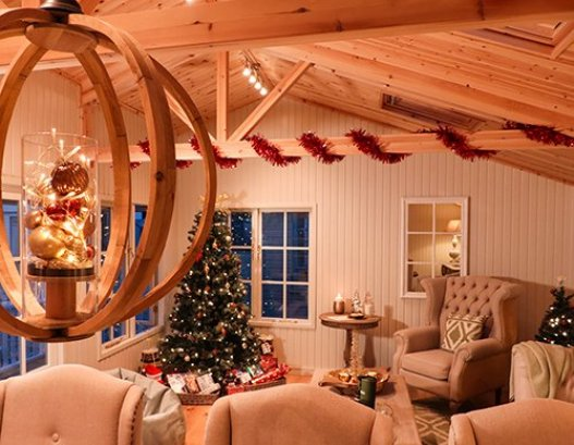 A Garden Room Decorated in a Red & Gold Theme for Christmas