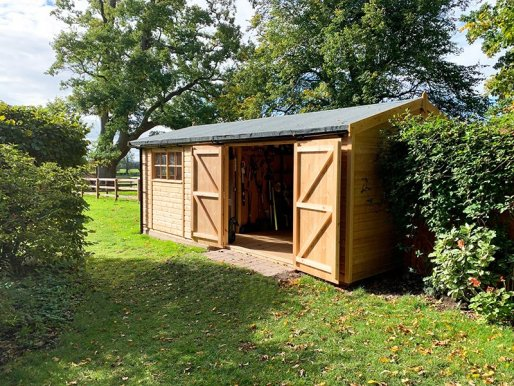 A customer's workshop - a 3.6 x 6.0m Superior Shed in Light Oak