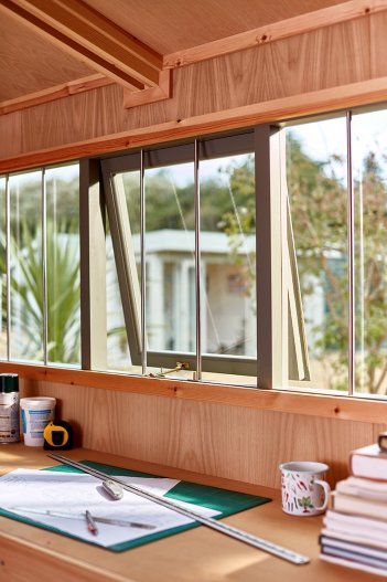Opening windows inside one of our Superior Sheds