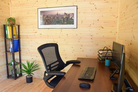 A Garden Office Interior complete with desk, computer and storage unit
