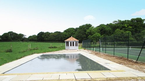 A Wiveton Summerhouse being used as a swimming pool house and a tennis room