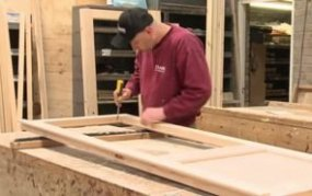Craftsman at our Norfolk factory HQ creating a door in our onsite joinery