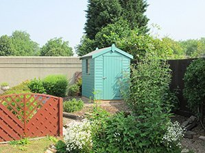 Classic shed painted in Mint Green