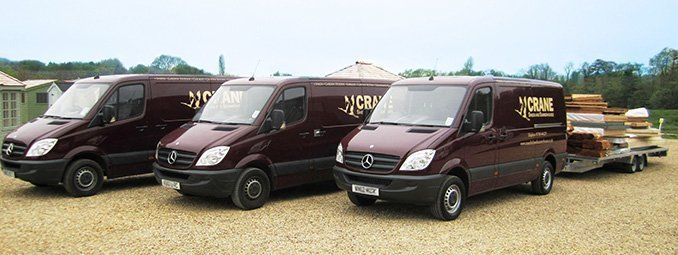 Crane Garden Buildings delivery vans, ready to deliver and install your bespoke timber building