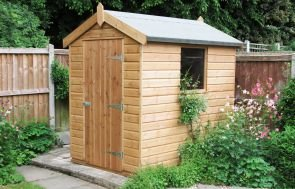 A classic garden shed with apex roof and shiplap timber coated in our light oak preservative stain which enhances the natural beauty of the wood.