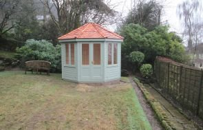Wiveton Summerhouse in Exterior Paint System Lizard Paint with Cedar Shingle tiles on the roof and Shiplap Cladding
