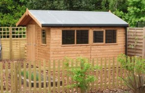 A stylish garden shed with natural light oak shiplap cladding and an apex roof covered in heavy-duty felt. The fascia boards have black guttering and several window sets feature one opening window.