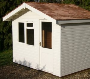 A sandstone painted Binham Garden Studio clad with shiplap timber. The apex roof is covered with cedar shingles.