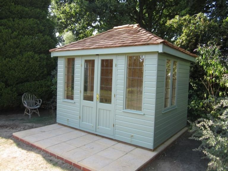 2.4 x 3.0m Cley Summerhouse with smooth shiplap cladding painted in Lizard, Leaded windows and Cedar Shingles on the roof
