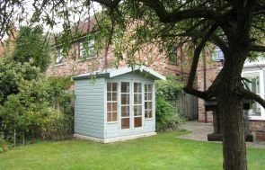 A charming, traditional style summerhouse with an apex roof covered in heavy-duty felt and smooth shiplap cladding