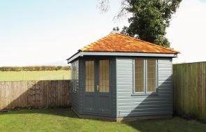 Weybourne Summerhouse with Exterior Paint System Paint in Slate with Shiplap Cladding and Leaded Windows