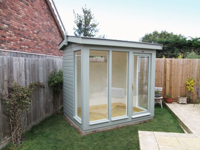 An attractive Garden Studio with a Slate covered apex roof and shiplap timber cladding. Fully-glazed windows give it a contemporary look and the interior lining has been painted. The exterior cladding is painted in Sage paint.