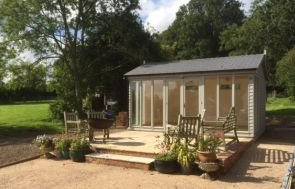 A lovely Burnham garden studio positioned on an area of decking with an apex roof