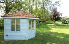 Weybourne Summerhouse in Exterior Paint System Verdigris Paint with Leaded Windows and Shiplap Cladding