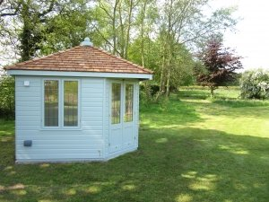 Weybourne Summerhouse in Valtti Verdigris Paint