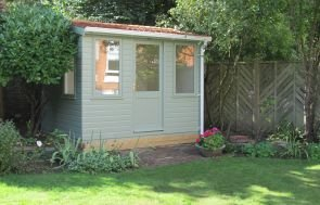 2.4 x 3.0m Langham Studio with white guttering and apex roof