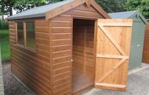 1.8 x 2.4m Classic Shed with Shiplap Cladding painted in Light Oak and an Apex Roof covered in Heavy Duty Felt