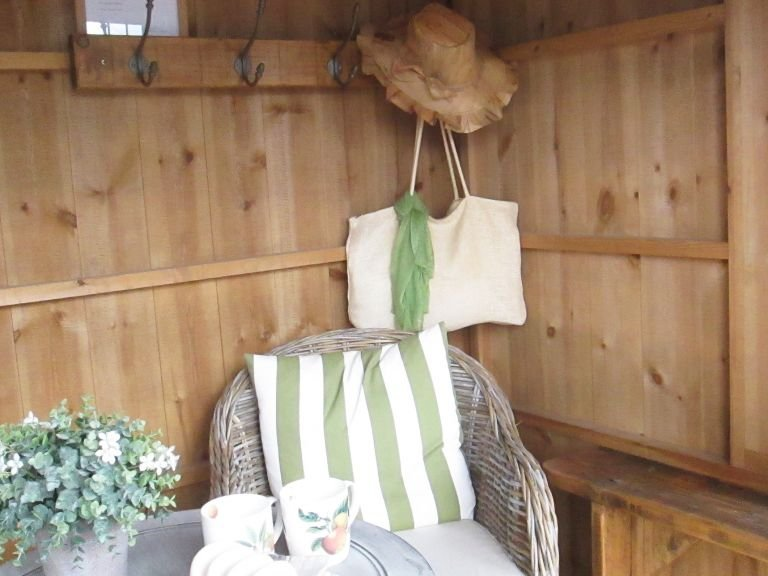 The interior of a National Trust Flatford Summerhouse with a relaxing, recreational set up
