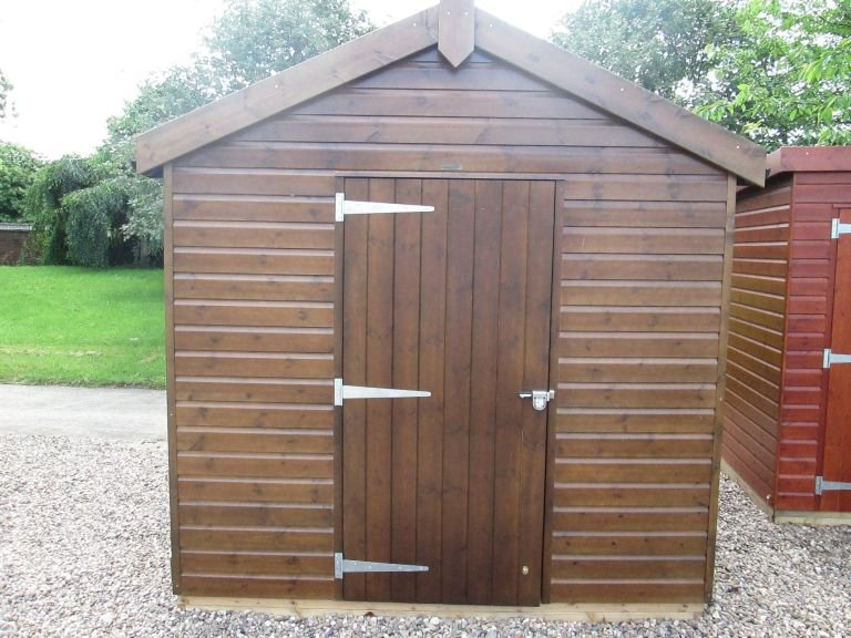 2.4 x 3.0m Superior Shed in Sikkens Walnut with Security Pack and a Workbench inside