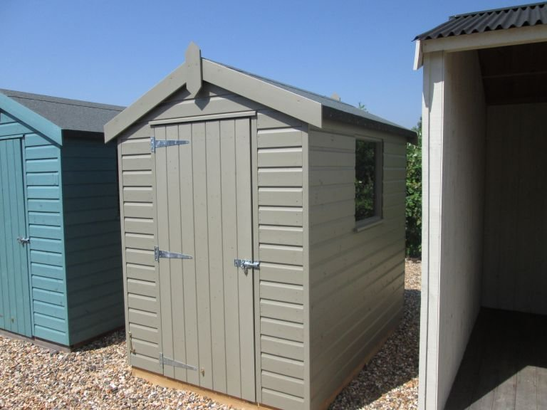 1.5 x 2.1m Classic Shed painted in the colour stone with an apex roof on display at our Brighton show site