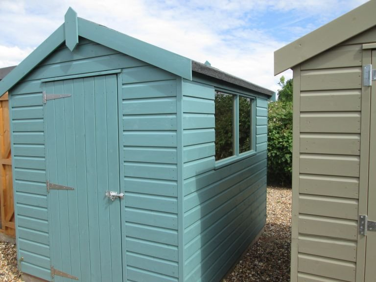1.8 x 2.4m Classic Shed with an Apex Roof and Shiplap cladding painted in Mint