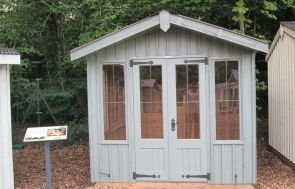 Ickworth National Trust Summerhouse with an apex roof and vertical timber cladding painted in terrace green