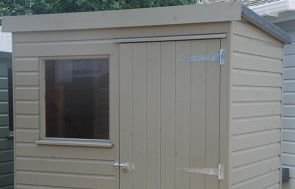 1.2m x 1.8m Classic Shed with a pent roof covered with heavy-duty felt and shiplap cladding painted in Stone