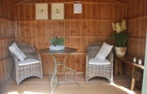 National Trust Ickworth Summerhouse interior with natural wood and seating area for two people.