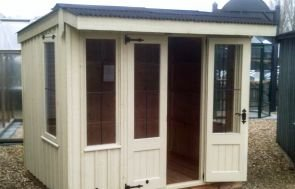 National Trust Flatford Summerhouse with a pent roof and vertical cladding painted in the shade of Dome Ochre