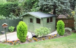 A charming garden shed with an apex roof and slight overhang covered in heavy-duty felt. The shed has smooth shiplap cladding painted with our green sikkens preservative and plain windows that open.