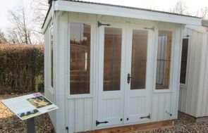 National Trust Flatford Summerhouse with a pent corrugated roof and leaded windows with cast iron door furniture