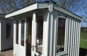National Trust Flatford Summerhouse with vertically sawn cladding and leaded windows