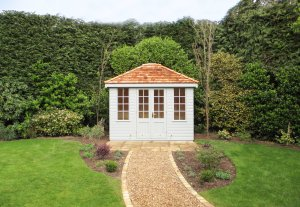 A classical, hipped roof summerhouse with shiplap cladd