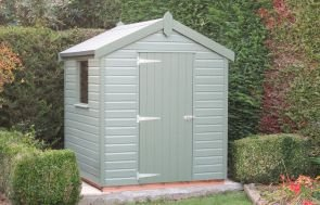 Classic Garden Shed in Moss Paint in an attractive garden with a large hedge behind it. The shed is clad with smooth shiplap and has a single window in the side, the apex roof is covered with heavy-duty, heat-bonded felt.
