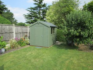 A compact classic garden shed with an apex felt roof and fixed windows in the length of the building.