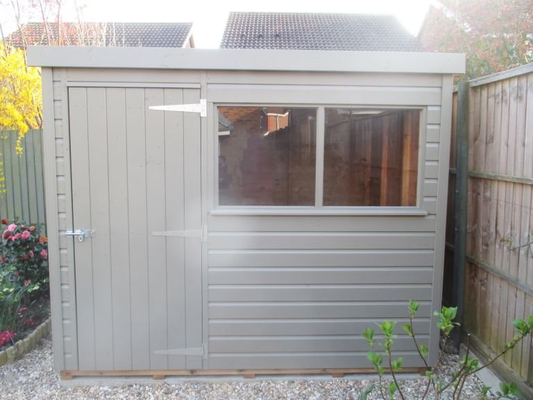 Classic Garden Shed with Pent Roof and two fixed windows in the length, There is also a single access door and the entire building is clad with smooth shiplap
