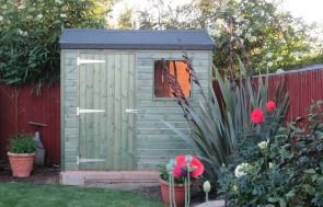 A small superior shed with shiplap cladding painted with our sikkens green preservative and featuring an apex, felt covered roof.