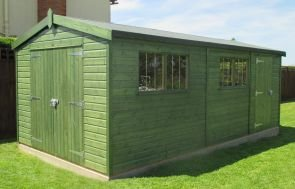 A Large Green superior shed painted in the Sikkens stain with weatherboard cladding. There are double doors in the gable end and visible window bars in the two window sets.