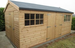 A large timber garden shed stained in light oak with a felt roof. It has double doors and georgian windows.