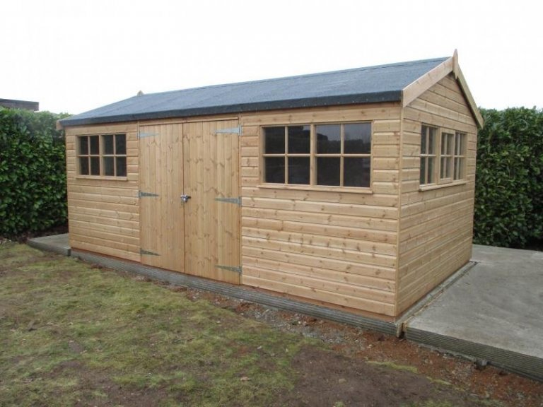 A large timber garden shed stained with a light oak preservative. It has an apex roof covered in heavy duty felt.