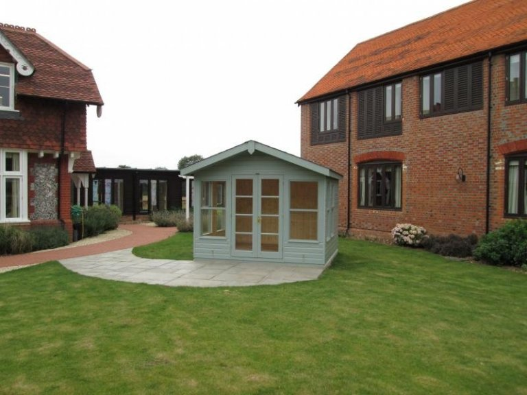 Blakeney Summerhouse Painted with our Exterior Paint System with an Overhanging Apex Roof Basingstoke