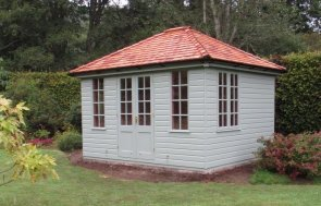 Attractive high quality summerhouse with hipped roof and shiplap cladding. It has several windows of georgian style and is an insulated summerhouse with electrics.