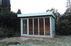 A modern and stylish garden studio with a pent roof and smooth shiplap cladding. The studio has electrics and natural pine lining.